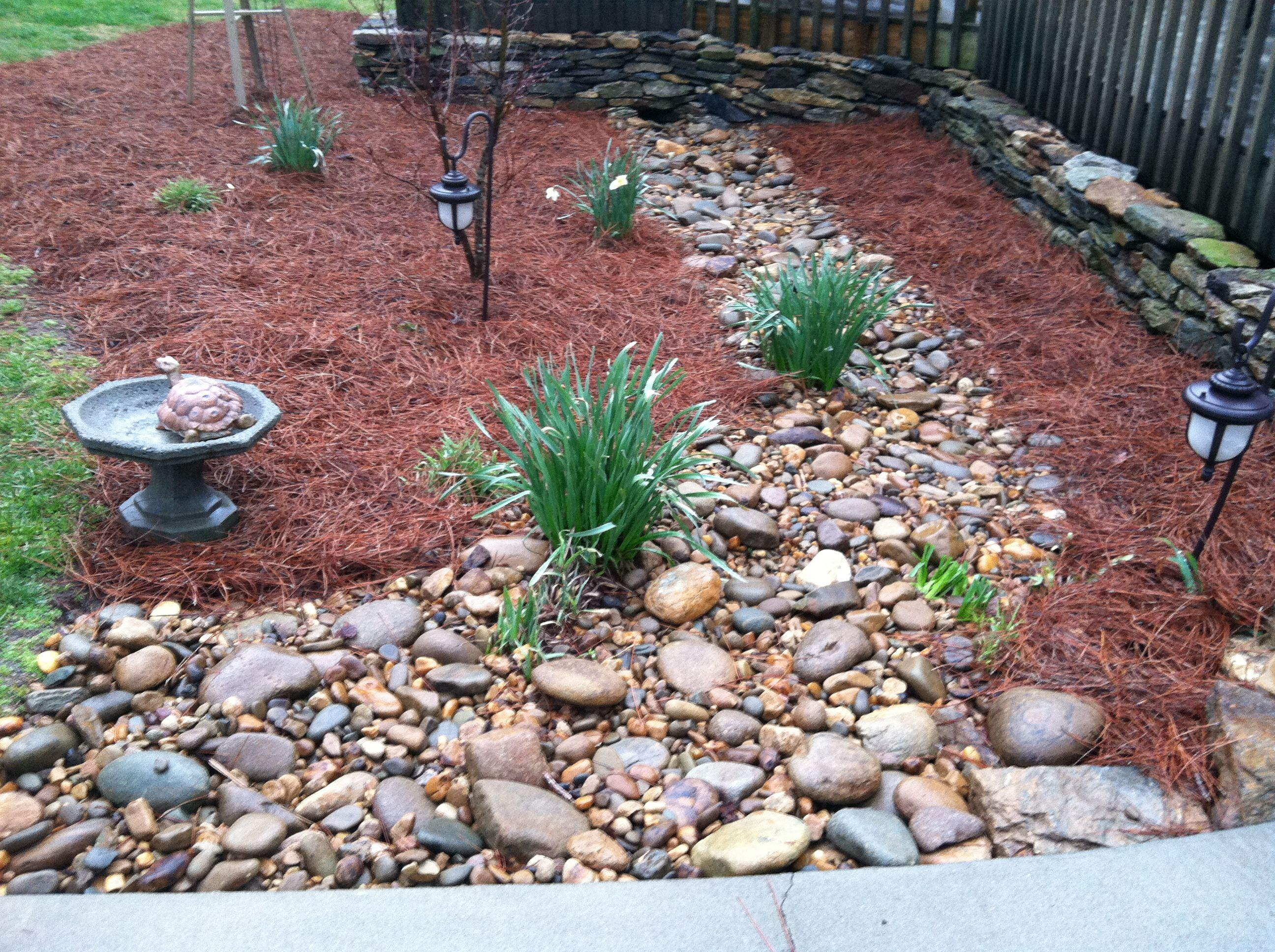 Dry creek bed for drainage. Despeartely need this in my