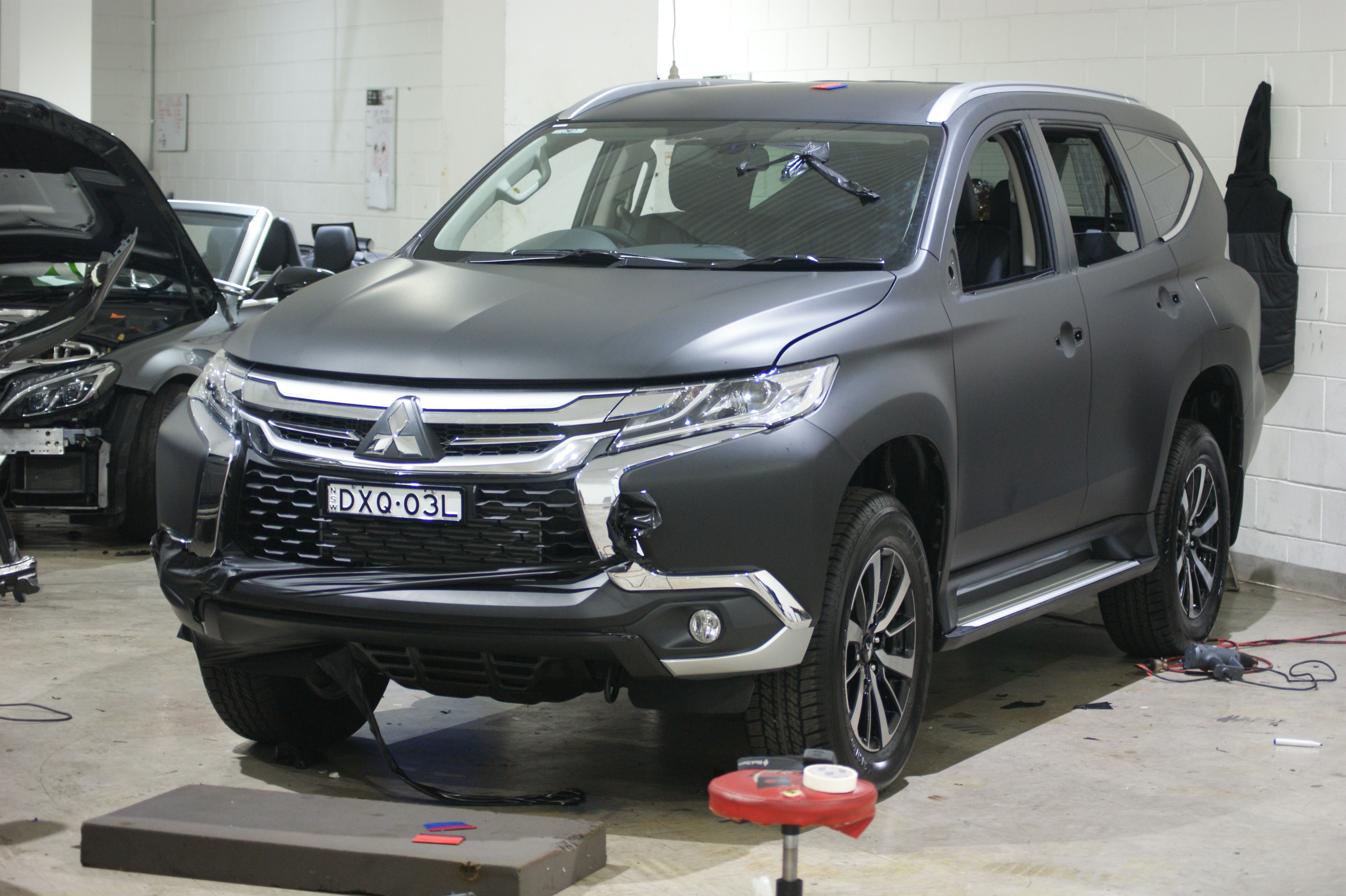 Stunning Mitsubishi Pajero Sport Being Wrapped In Matte Black To Give It A Standout Look On The Road Mitsubishi Pajero Sport Car Wrap Mitsubishi Pajero