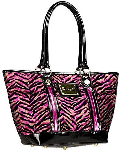 Betseyville- I have this purse and I do love it!
