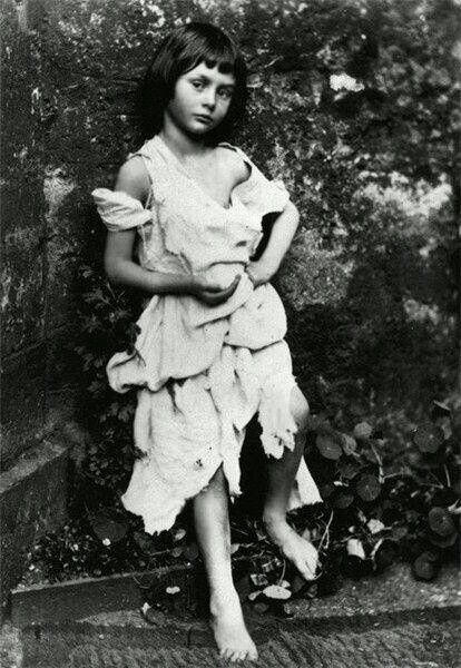 Alice Liddell, the girl who inspired Alice in Wonderland. Photographed by Lewis Carroll in 1858.