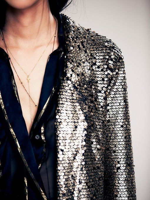 Metallic sequin blazer with stretch lace lining and hem in a raw zigzag pattern.