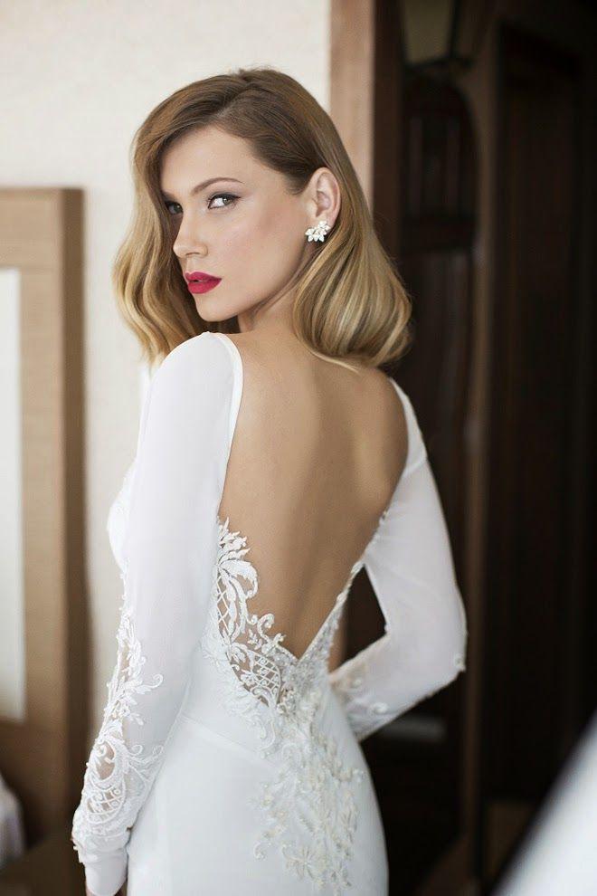 Figurbetontes Designer-Brautkleid, rückenfrei mit Spitzen ...