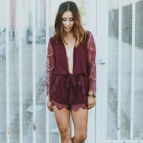 This rich plum color is perfect for the holiday season. The full lace sleeves and lace trimmed shorts are delicate and soft. Counter the sweetness with a dramatic open draped front with low tied sash. This unbelieveably easy to wear romper is one of a kind.