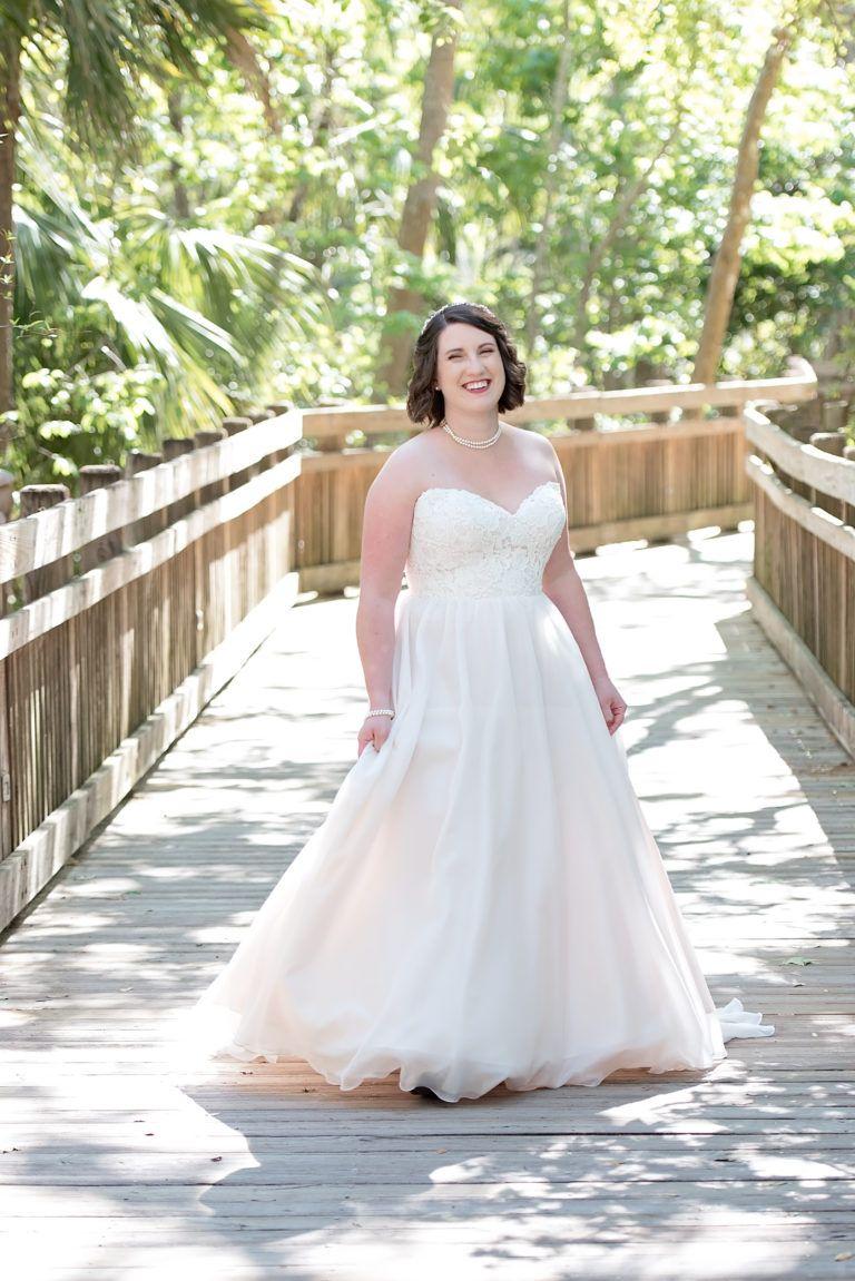 Essense wedding dress  Bride in her strapless Essense of Australia wedding dress from The