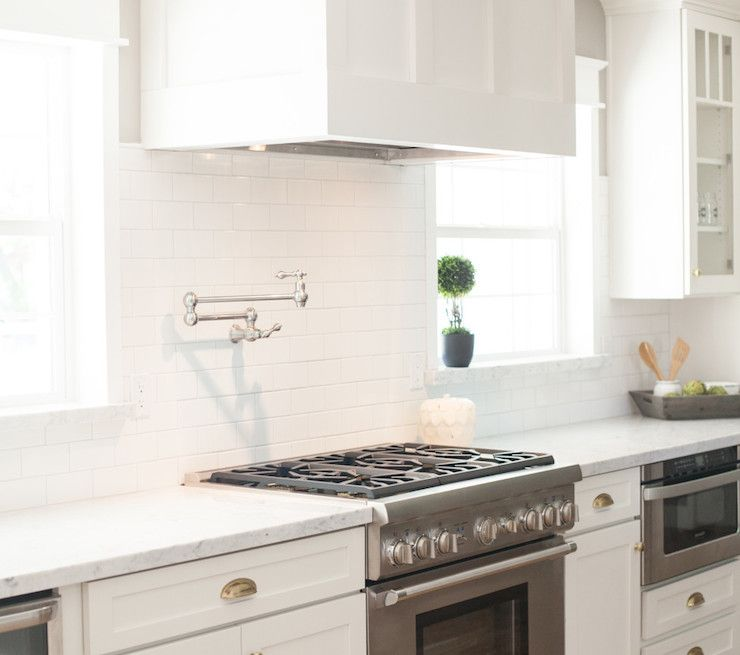 Beautiful White Kitchen With Below The Counter Microwave