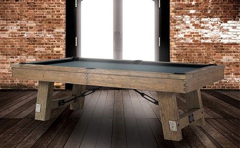 the isaac pool table, with its steel turnbuckle, solid oak angled