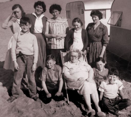 Picture of family goup outside a caravan. Costume history ...