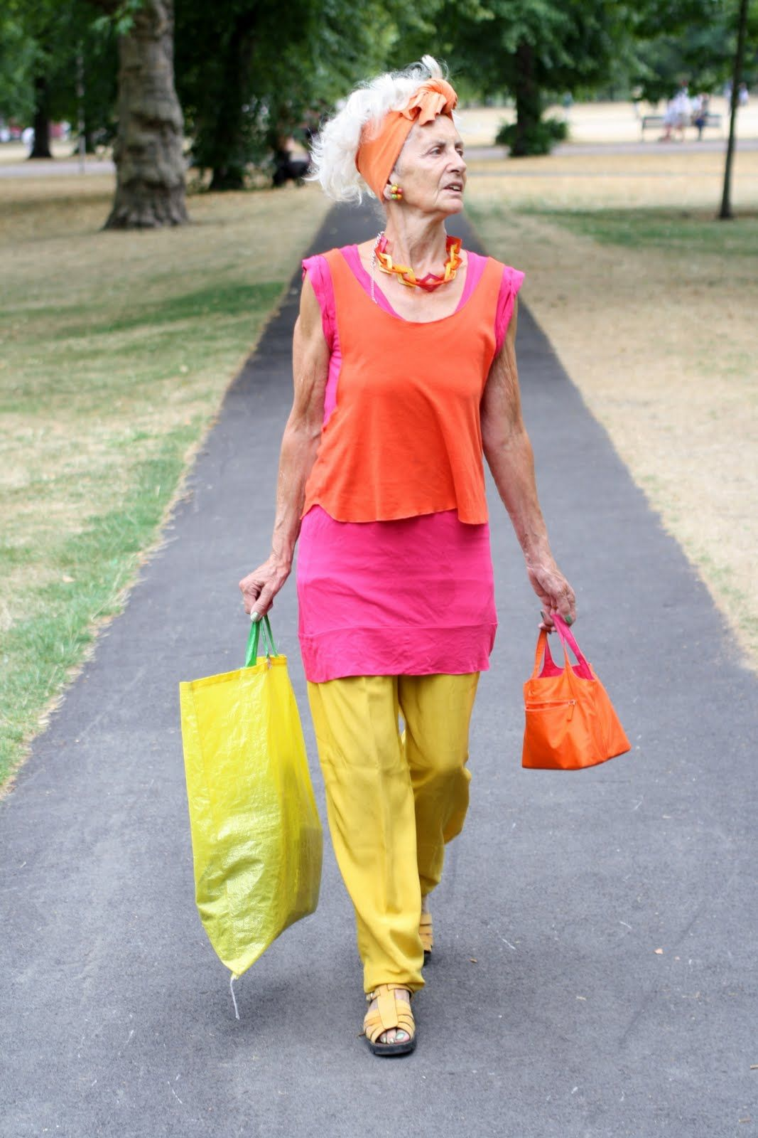 """LOVE this! Another pinner said: """"She could be following the color blocking trend, or she might just be loving the popart colors~who cares?? At this age do whatever you want and if others think you have demetia, let them! Give yourself a smile then whack 'em with your eco-friendly shopping bag!"""" :)))"""