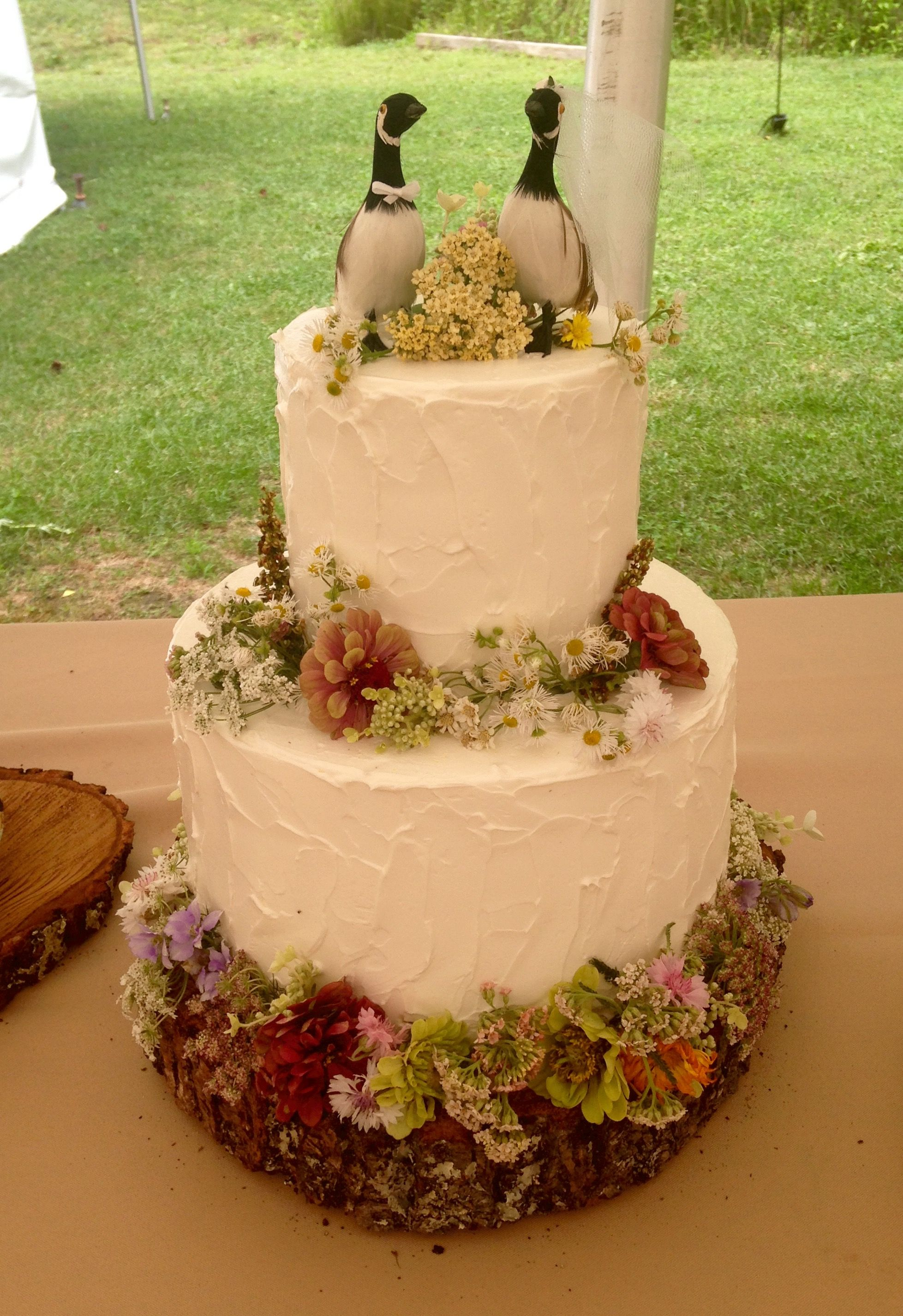 Rustic Buttercream wedding cake with fresh wild flowers and geese ...