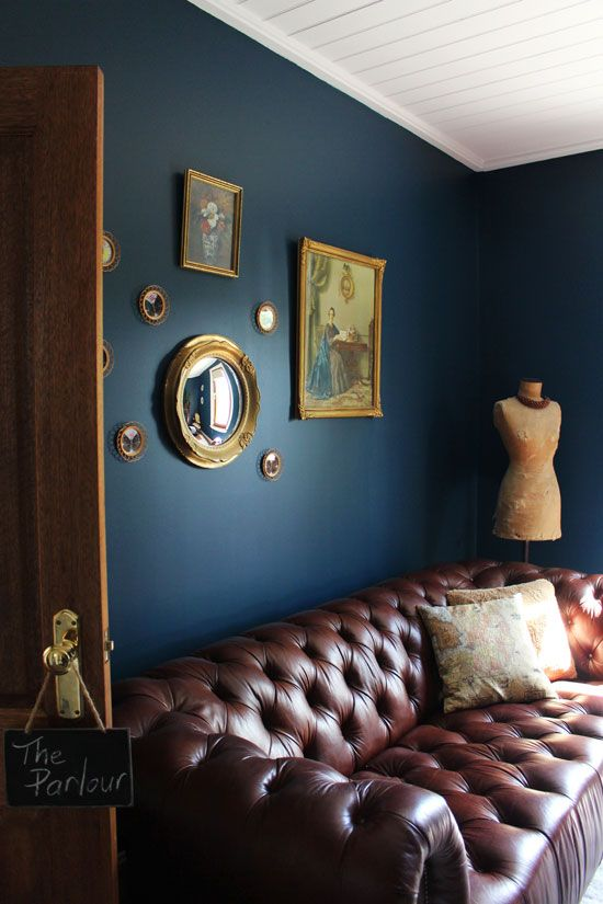 Basement Ideas Blue Wall Gold Frames Leather Dark Living Rooms