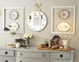 vintage plates and mirror in empty frames... so chic