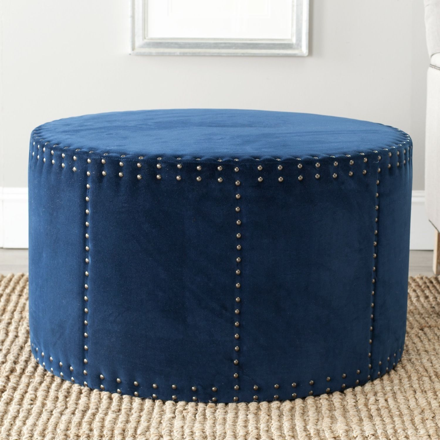 Brass nailhead details infuse the round Sherri ottoman by Safavieh ...