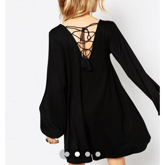 Asos Swing Dress with Lace-Up Back Flowy dress with split bell sleeves and a lace-up back. Ties with a pretty bow or knot with long tassels and is adjustable. Super flattering on any body type, and the material is so so soft. Can be dressed up or worn casually on weekends. Brand new, never worn! ASOS Dresses Mini