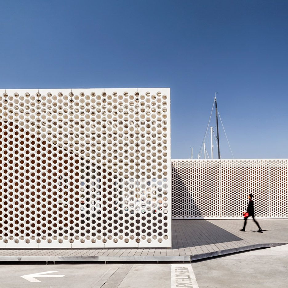 Perforated screens cover Barcelona marina buildings by SCOB Architecture and Landscape