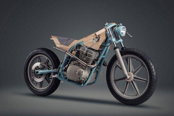 Le studio de design italien Joe Velluto a collaboré avec la société de fabrication de motos sur mesure North East Custom, pour réaliser une pièce unique qui remplace le métal et le plastique avec du bois, du verre et de la laine.  Exposée à la Triennale de Milan durant la semaine du design, la JVLT014 est mi-moto, mi-sculpture et a été conçue comme un meuble qui a les caractéristiques d'un mode de transport. La moto est inspirée par le monde du mobilier, devenir un objet, être admirée.