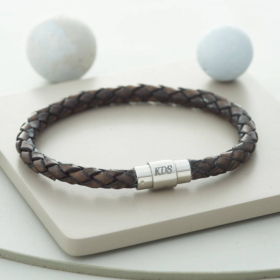 442018c3d A handsome personalised plaited leather and stainless steel bracelet.Personalisation  is carried out in our