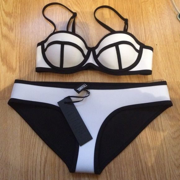 White triangl set NWT The top is Xxs although the picture makes it look like it says XS and the bottoms are XS. Brand new and never been used. I'm open to trades, mainly on triangl or lululemon I will sell for $78 on merc triangl swimwear Swim Bikinis