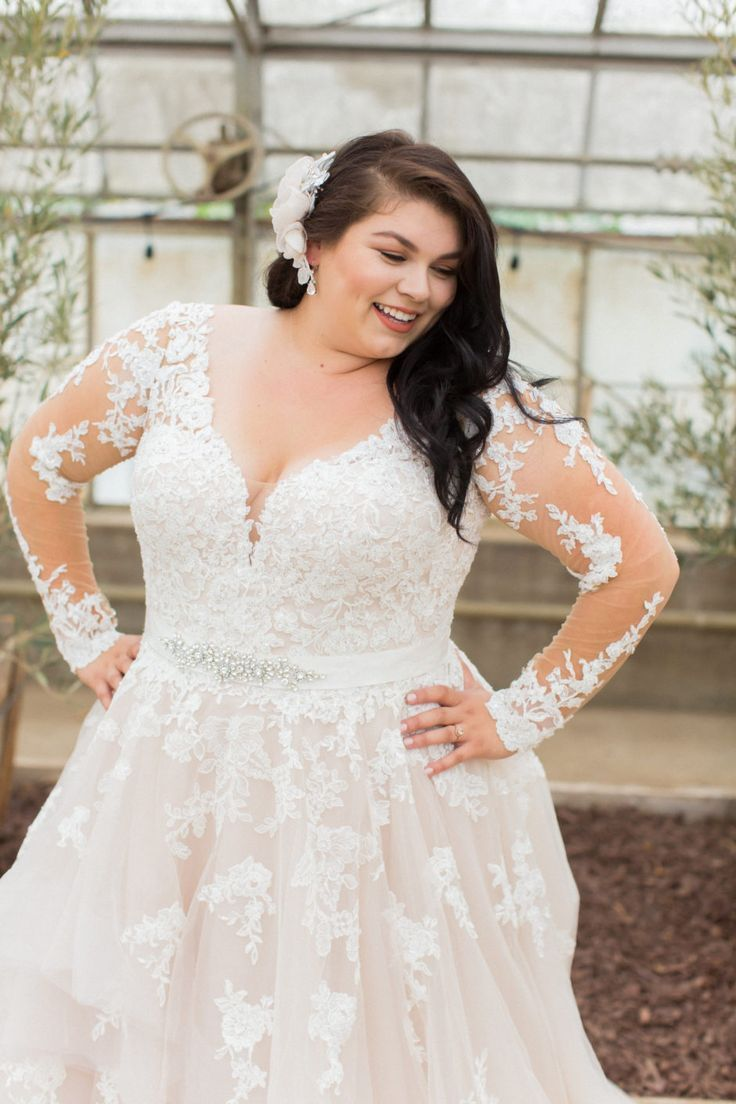 Classic curvy bride long sheer sleeves and just a hint of cleavage
