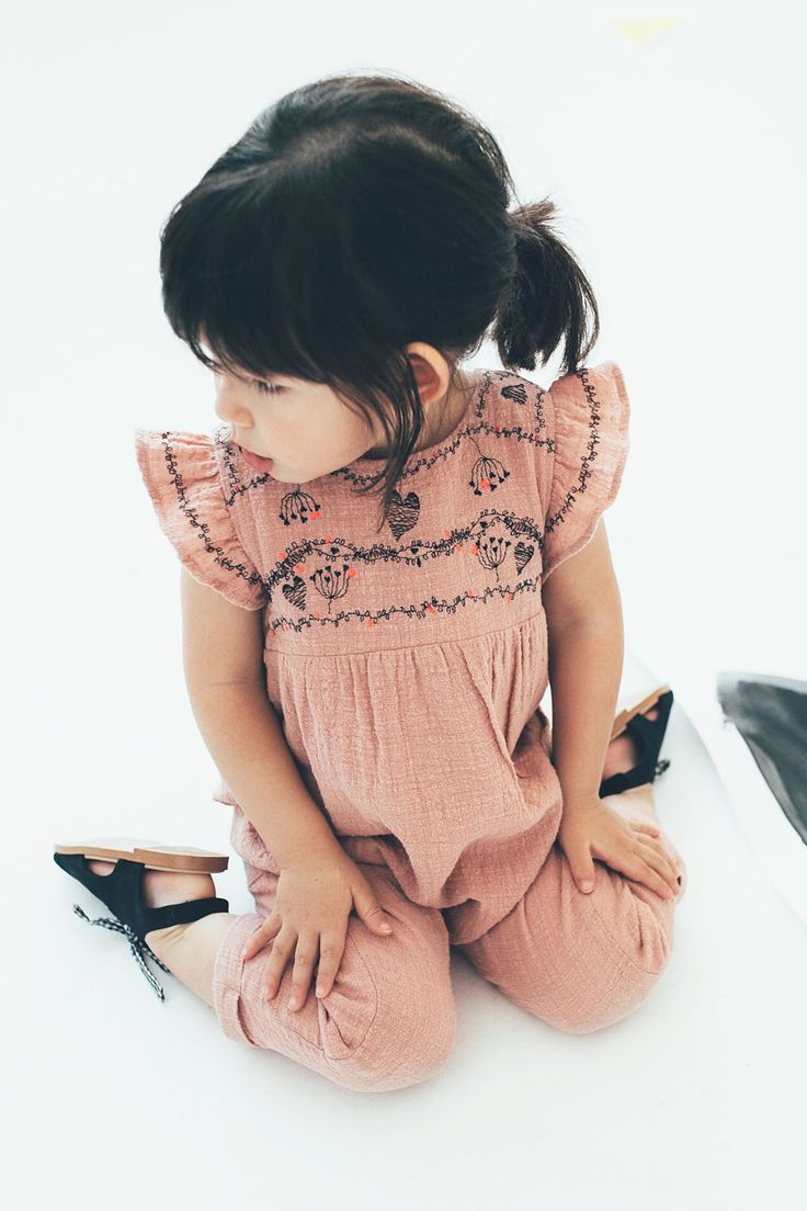 12fc889b7 This little one piece with frills on the shoulder is idyllic for ...