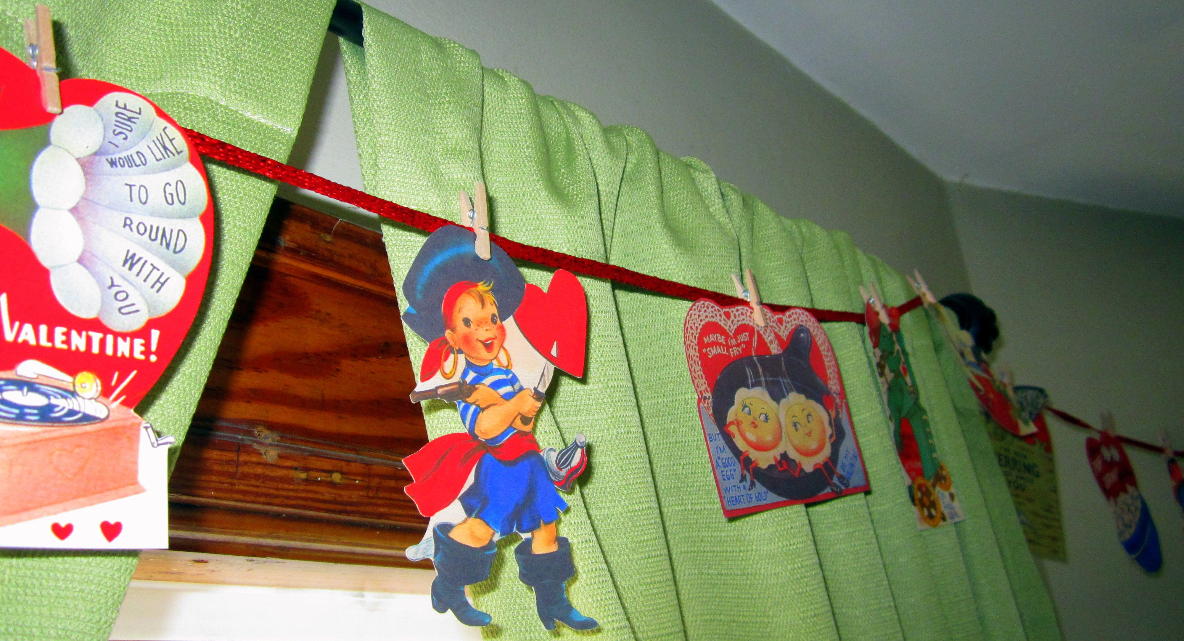 Vintage Valentine's Banner.  PRINTED from Flickr, CUT around edges, HUNG on ribbon with mini clothespins.