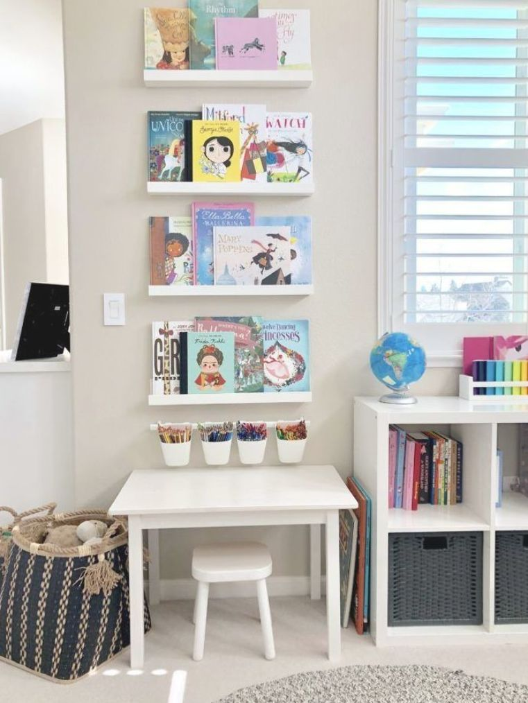 bright and colorful playroom with wooden play house with kitchen and cubby shelves #playroom #playroomideas #kidsroom #kidsdecor