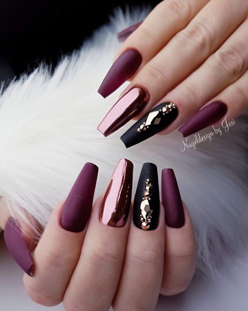 Deep maroon or purple coffin nails