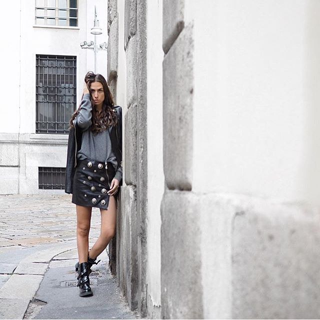 The bold style choice of @erika_boldrin: a black #VersusVersace skirt with Lion Head studs and a @versace_official biker jacket. #Regram