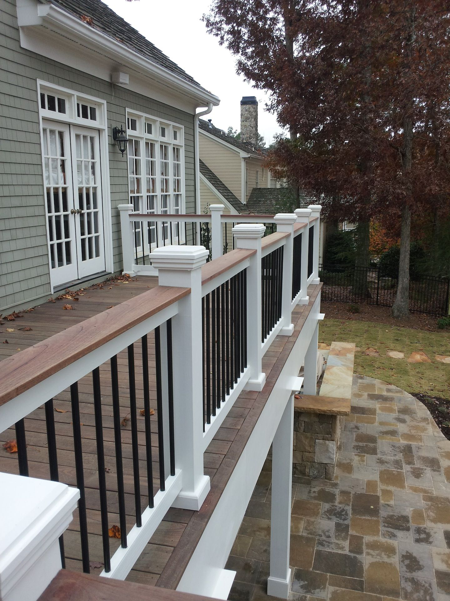 Deck color with all white rails two tone or three tone deck rails can tie it all together when it comes to the colors of your siding trim roof etc