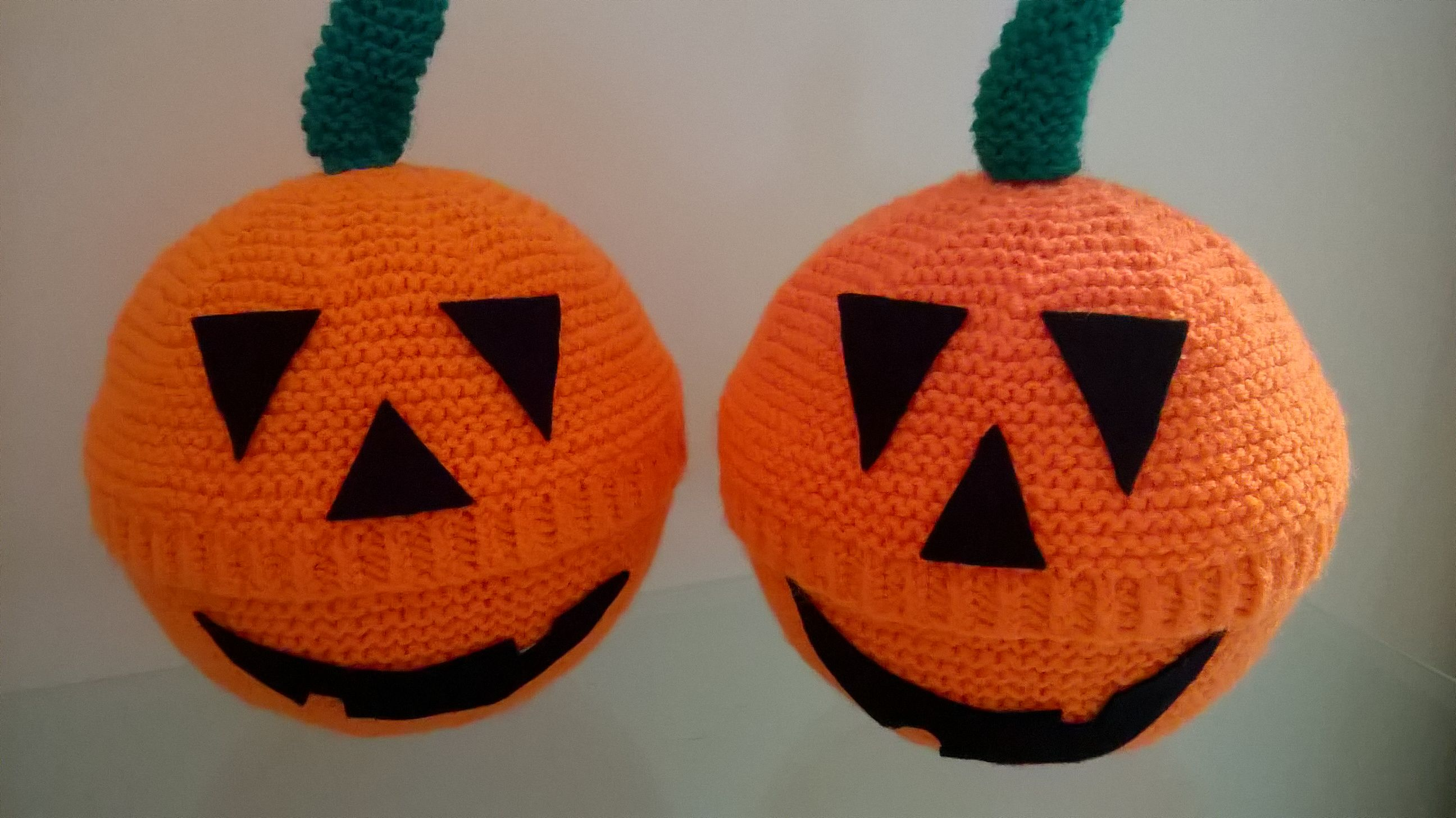 Hand Knitted Pumpkin Covers Over A Plastic Vessel Full Of