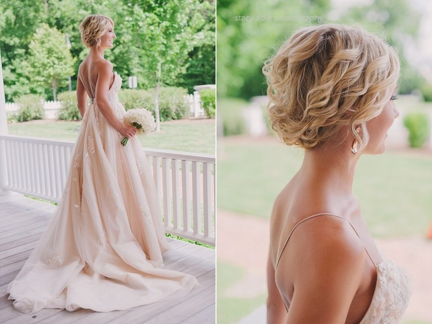 Love this bride's blush pink dress and hair!