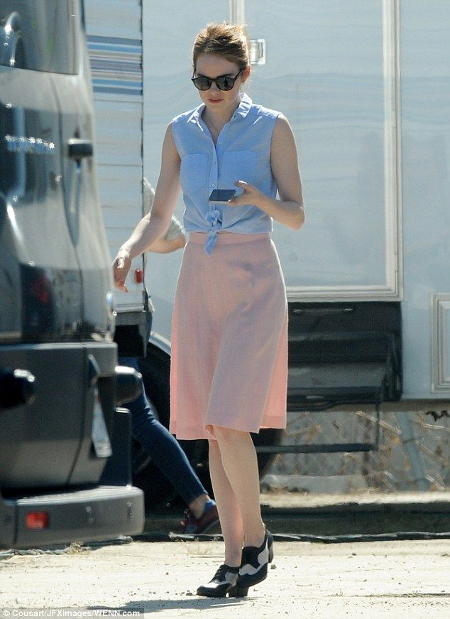 Pretty in pastel  The red-haired star looked equally fetching in a pale  blue tied blouse and pale pink skirt with vintage loafers 3e527b70c