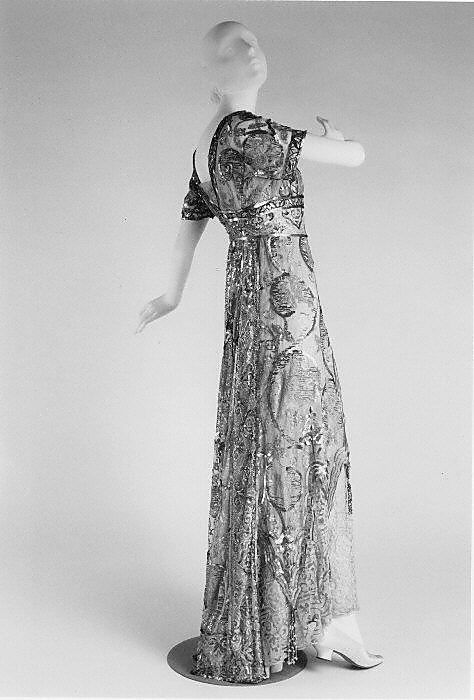 Evening dress (rear view) Callot Soeurs (French, active 1895–1937) Date: 1910–14 Culture: French Medium: cotton, silk, metal Dimensions: Length at CB: 55 1/2 in. (141 cm) Credit Line: The Jacqueline Loewe Fowler Costume Collection, Gift of Jacqueline Loewe Fowler, 1981 Accession Number: 1981.380.2