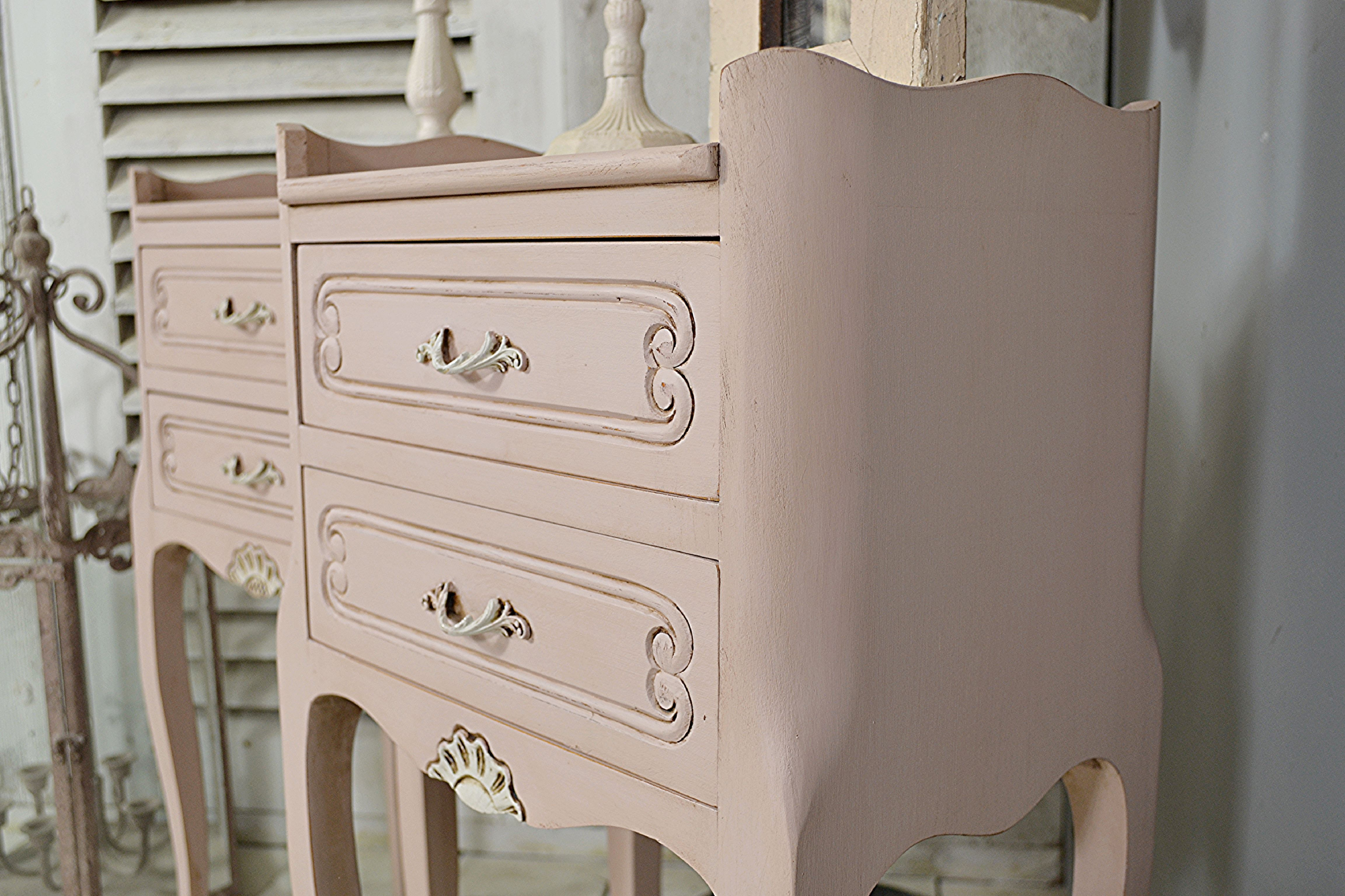 #letstrove This pair of 2 Drawer Vintage French Bedside Tables will bring charm and sophistication to any bedroom! We love their cabriole feet and pretty handles with his and hers shell detail. We've painted in Mylands Soho House, with Zoffany Quarter Empire Grey detail, a light distress and dark wax to age.  #pink #mylandspaint #frenchvintage #bedsidetables #frenchfurniture #shabbychic #vintage #zoffany