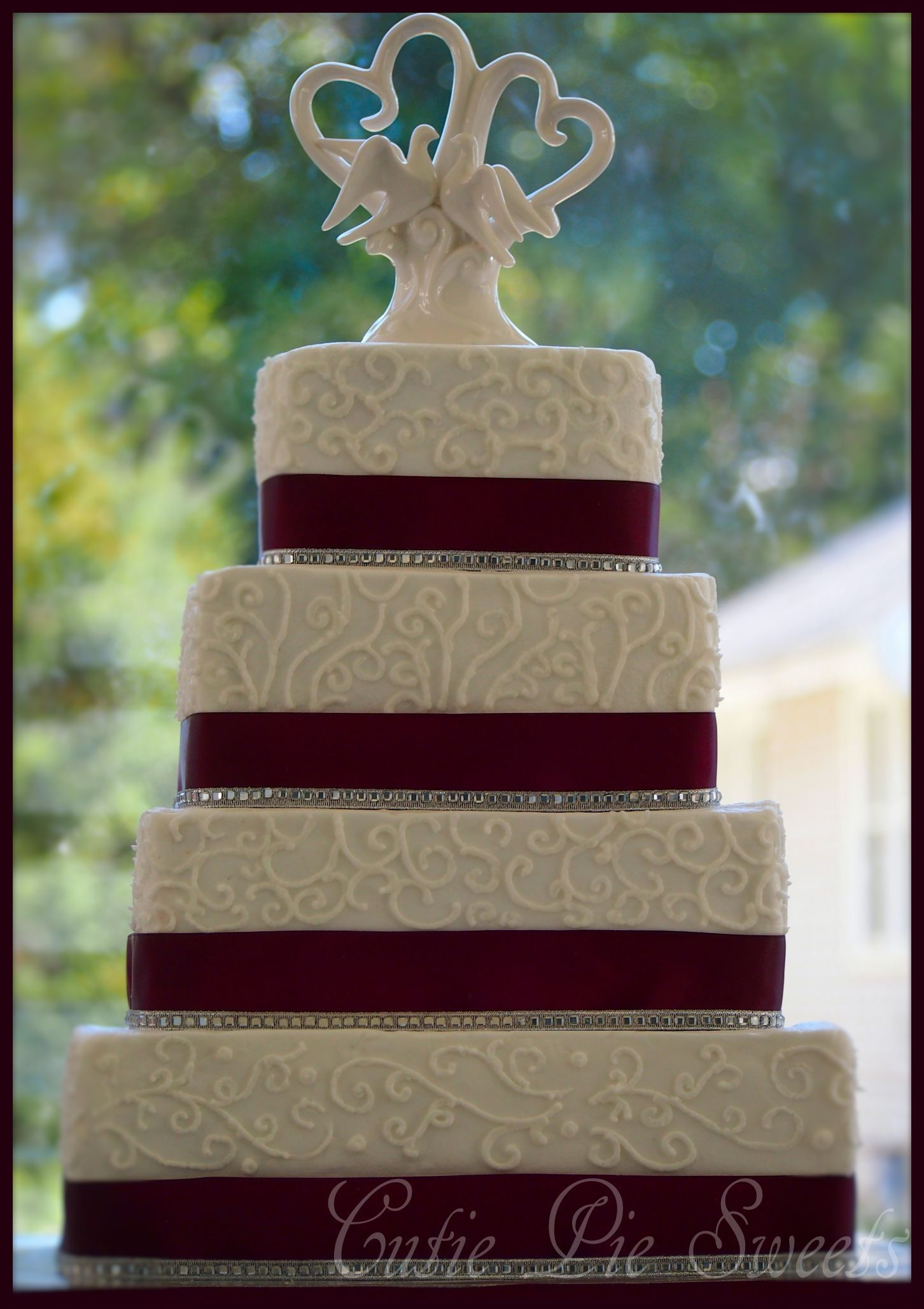 4 tiered plum square scrolled wedding cake square