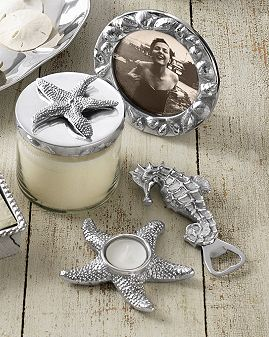 Mariposa Seaside Accessories: Bring undersea treasures to your table with our Seaside collection. Inspired by oceans splendor and riches including a seahorse bottle opener, starfish tea light, starfish candle and round shell frame.  By Mariposa. See sizes below.