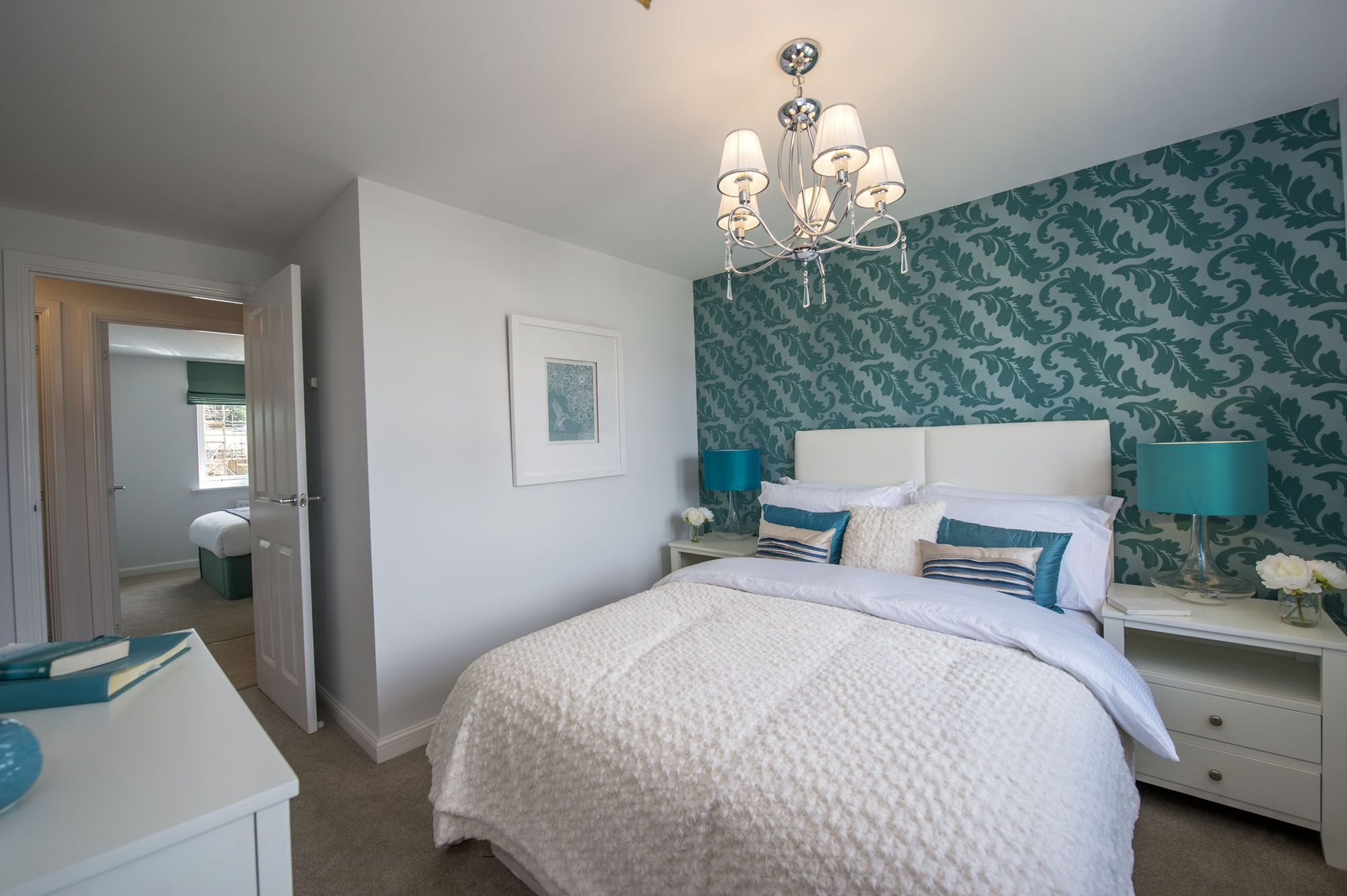 interior designed modern guest bedroom using aqua teal and chalk white colour scheme love those metallic teal lamp shades and the leaf wallpaper - Metallic Bedroom 2015