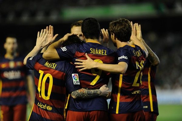 Barcelona's players celebrate a goal during the Spanish league football match Real Betis Balompie vs FC Barcelona at the Benito Villamarin stadium in Sevilla on April 30, 2016.