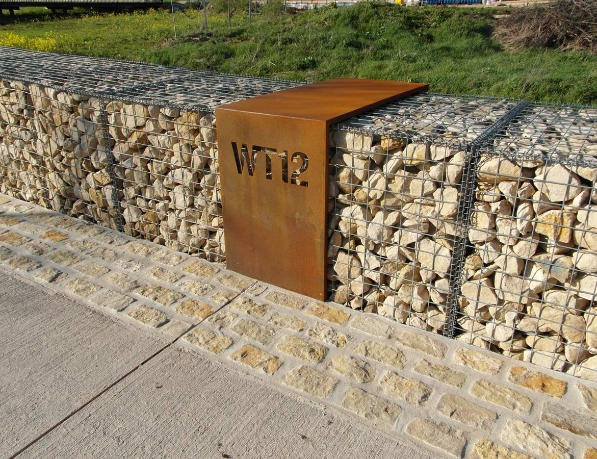 Gabion wall with house number signage Gabion wall design
