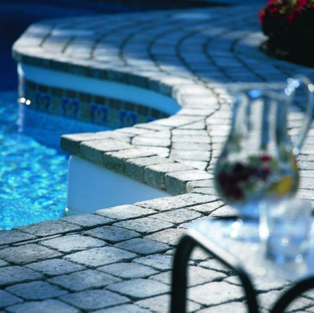 Swimming Pool Wonderful Stone Pool Desk Design Curved Swimming Pool Design Ideas With Paving Stone Deck And Outdoor Fur Stone Pool Stone Pool Deck Deck Design