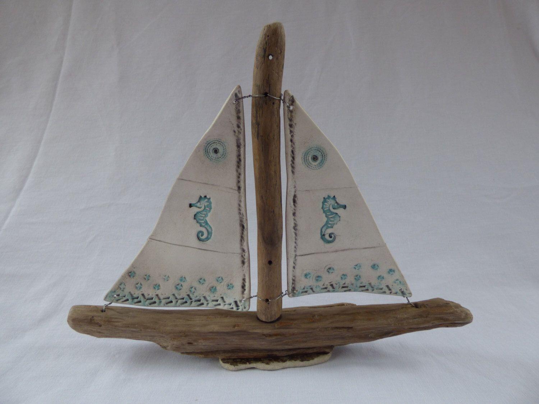 Clay sail driftwood boat by SharwoodDecor on Etsy https://www.etsy.com/uk/listing/469847941/clay-sail-driftwood-boat