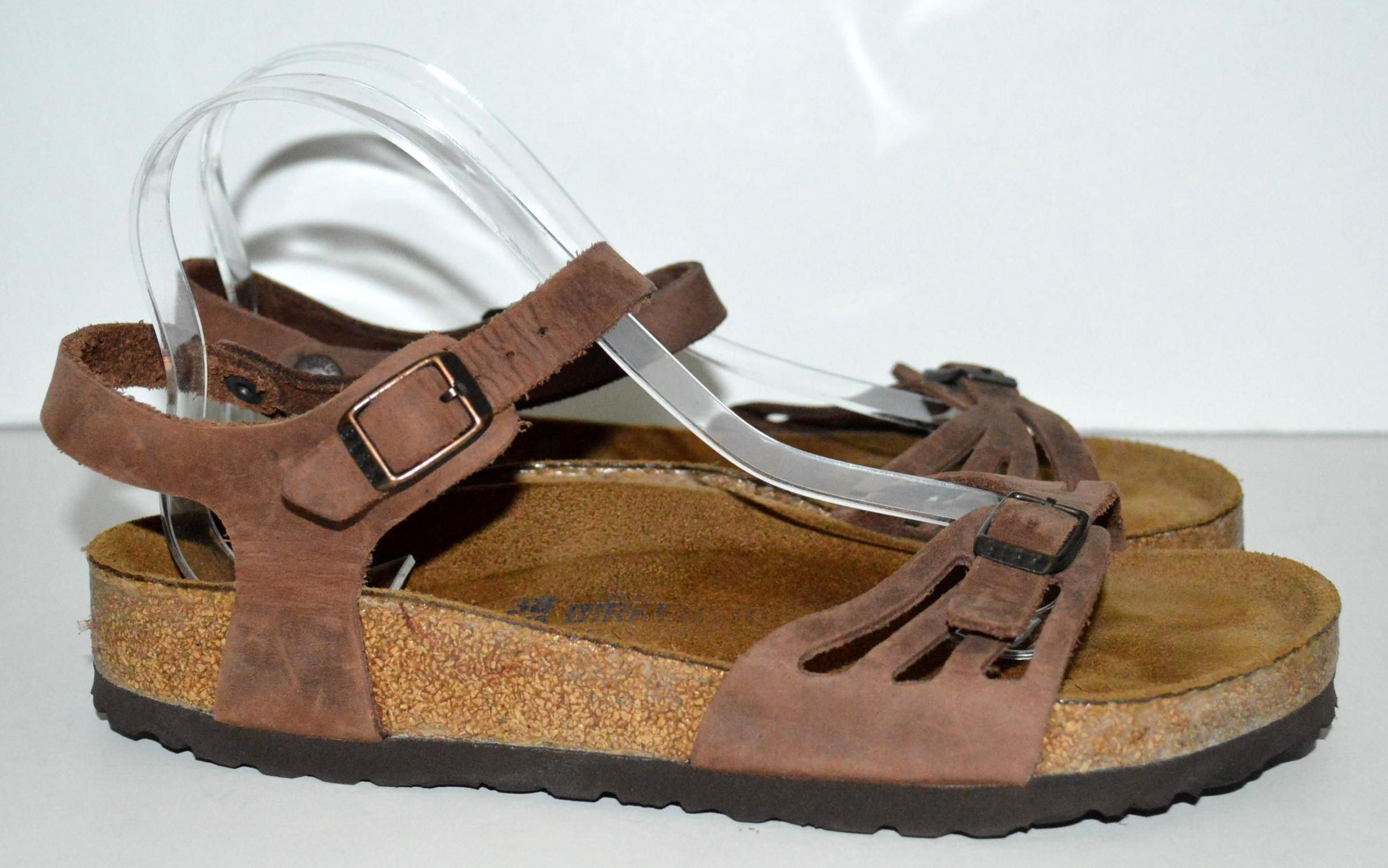 ef4a858af74cc1 Birkenstock Bali Brown Sandals. Get the must-have sandals of this season!  These Birkenstock Bali Brown Sandals are a top 10…