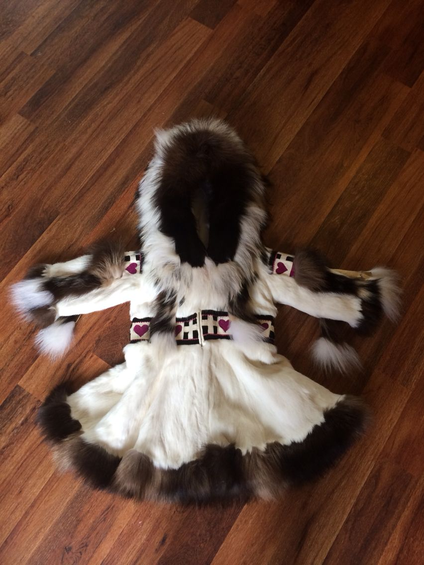 Traditional fur parka made of white rabbit, wolverine, wolf, calfskin and beadwork.