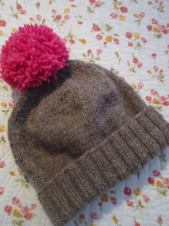 Grey wool bobble hat with pink pom pom