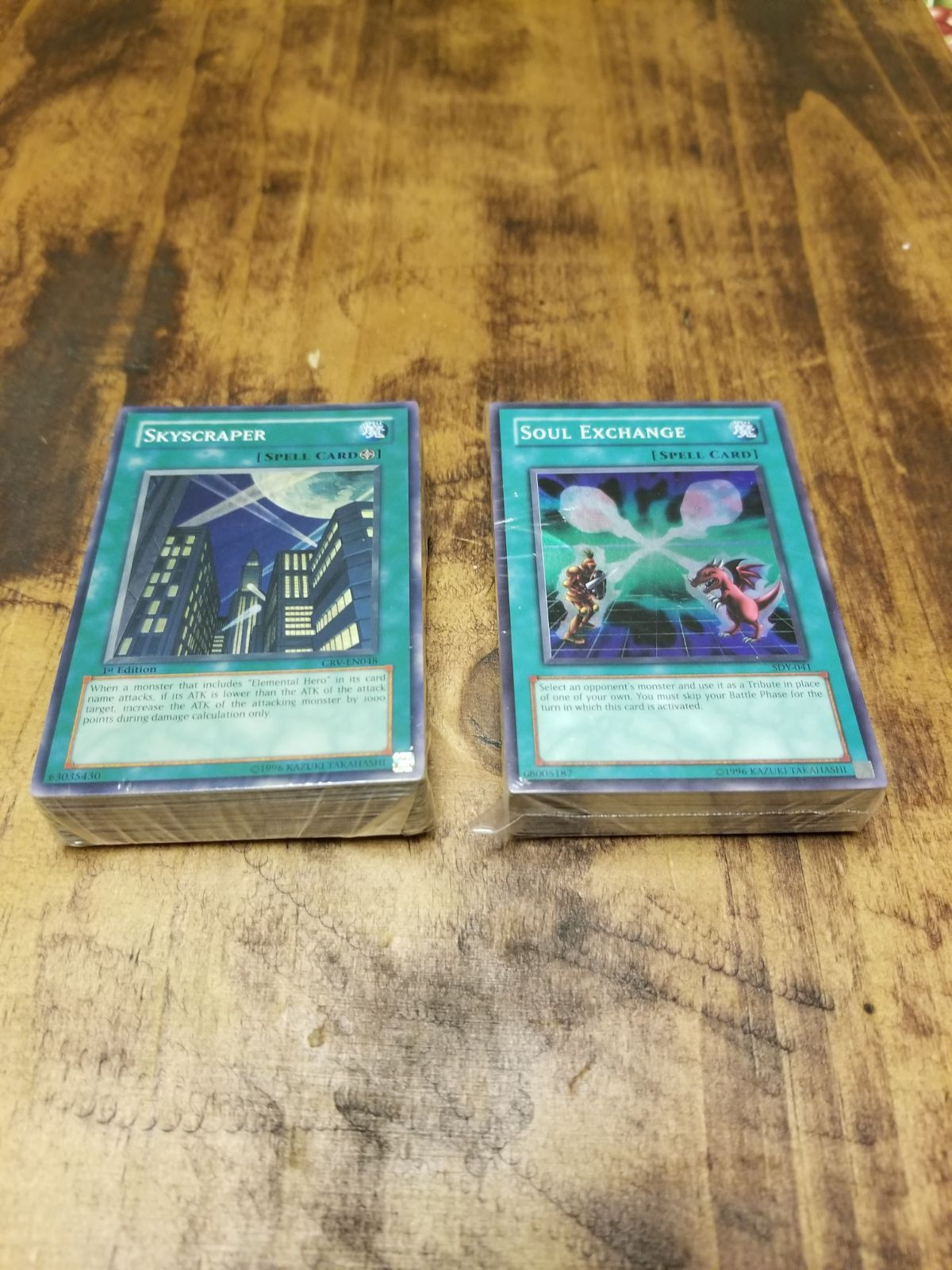 48 yugioh spell cards 4 holo cards included they are in