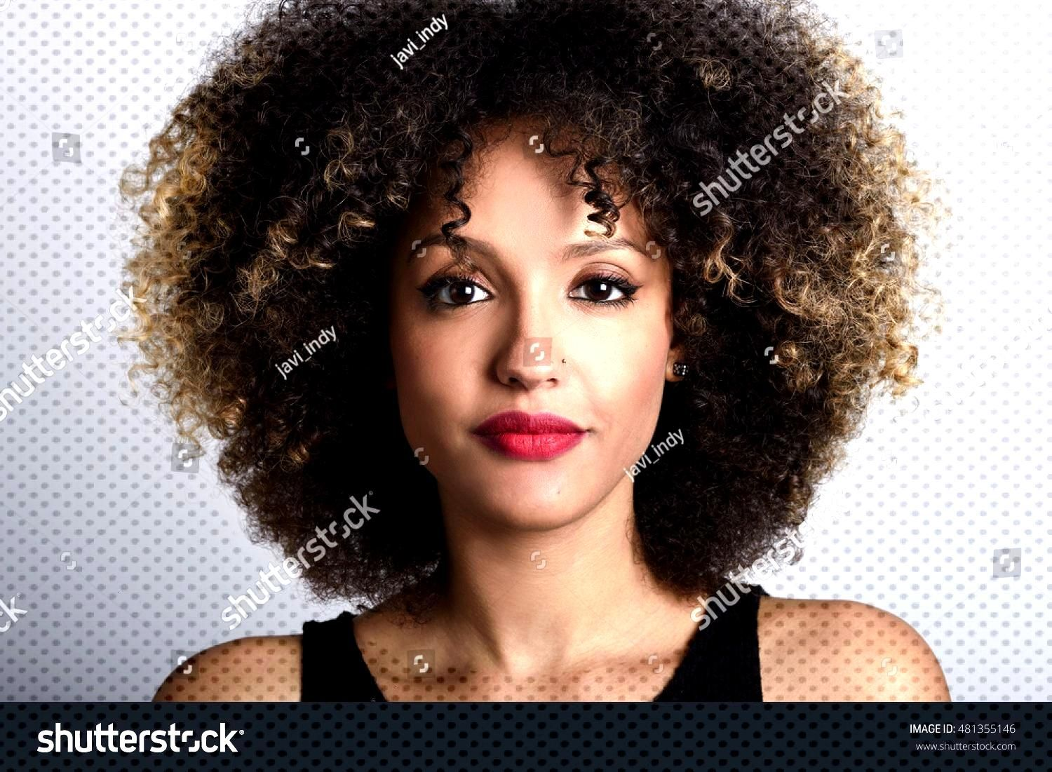 Young black woman with afro hairstyle on white background. Girl with african hairstyle. Studio shot