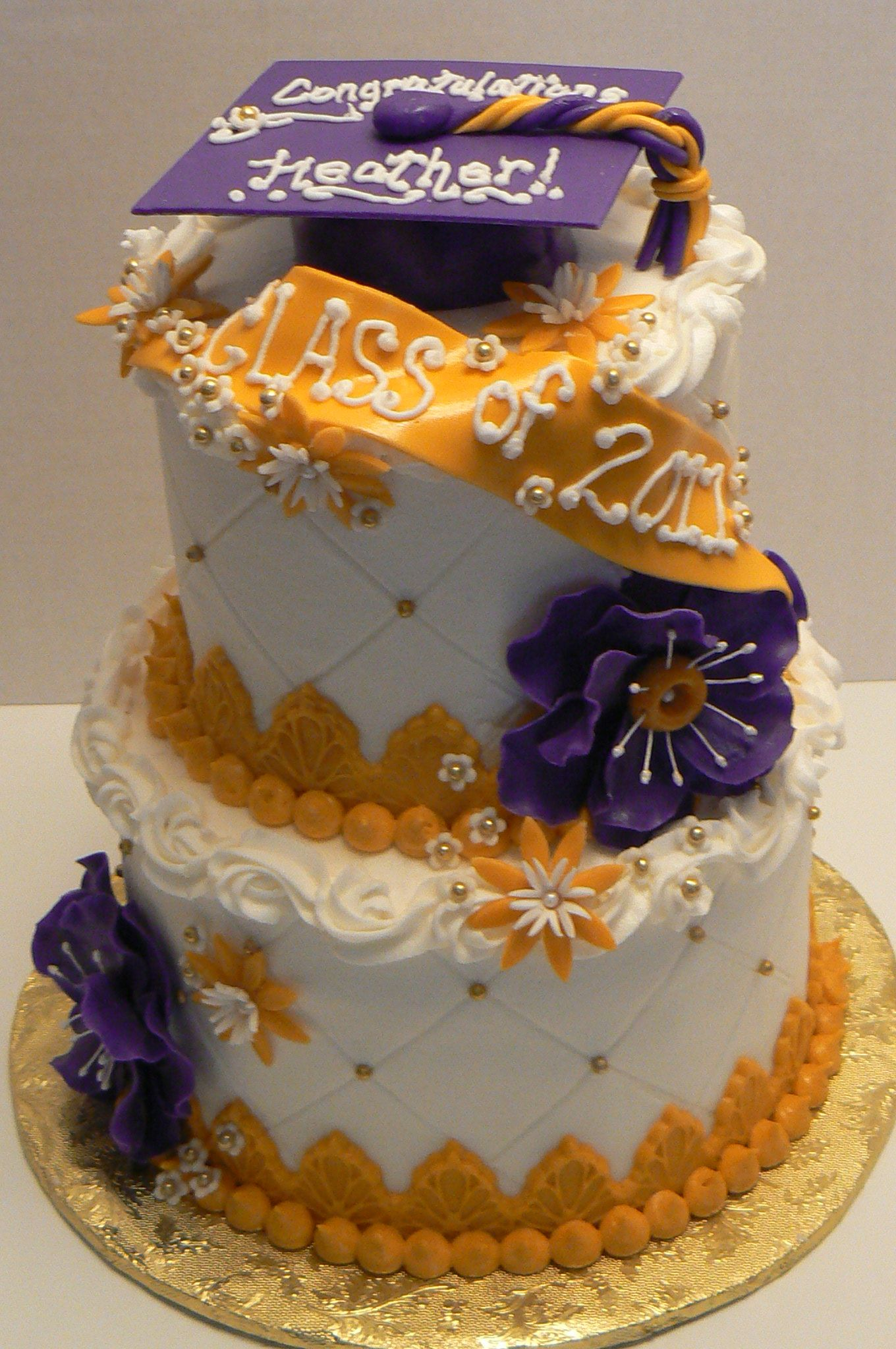 Heather's Graduation Cake - I made this cake for a young lady's graduation.  Her school colors are purple and gold and she wanted a white cake with vanilla filling and vanilla buttercream.  I'm having a ball making the anemones- this is the second cake I've made them for recently.