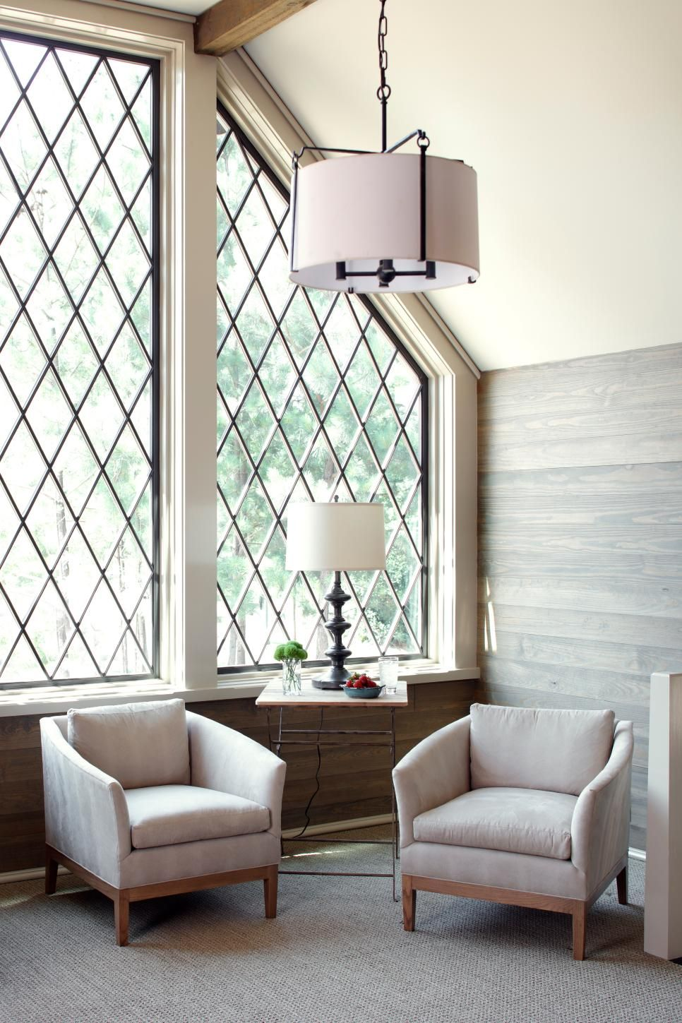 Large Criss Cross Paned Windows Fill This Sitting Area With Ample Natural Light Making It A Prime Spot For Enjoying Conversation And