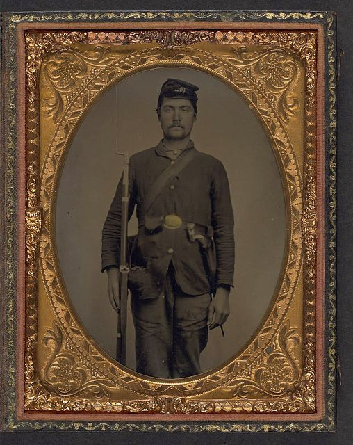 [Unidentified soldier in Union uniform with bayoneted musket, bayonet in scabbard, and cap box] (LOC) by The Library of Congress, via Flickr