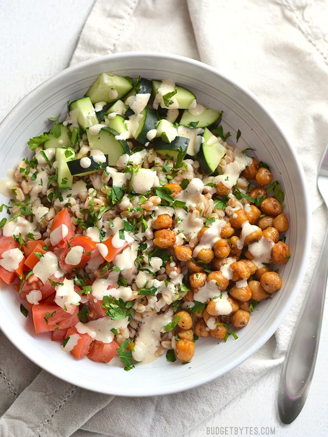 This Mediterranean Farro Salad with Spiced Chickpeas is packed with flavor, texture, and nutrients (and no animal products!). Step by step photos. - BudgetBytes.com