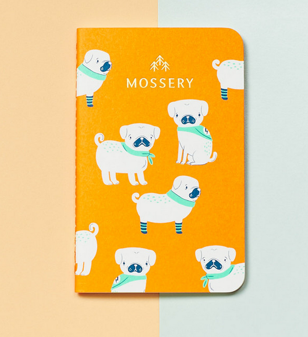 A pocket notebook decorated with pugs. Pocket notebook